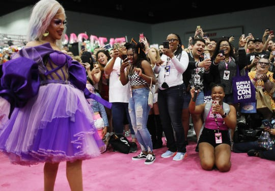 Attendees cheer as Ariel Versace poses at RuPaul's DragCon LA 2019 at the Los Angeles Convention Center on May 25.