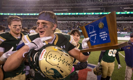 Red Bank Catholic, with senior tight end and Notre Dame-recruit Kevin Bauman (shown holding the NJSIAA Nonpublic Group III trophy last season) leading the way is the slight favorite in the rugged Shore Conference American Division.