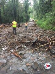 N.C. DOT assesses the landslides that blocked US 19/74 on Aug. 24.