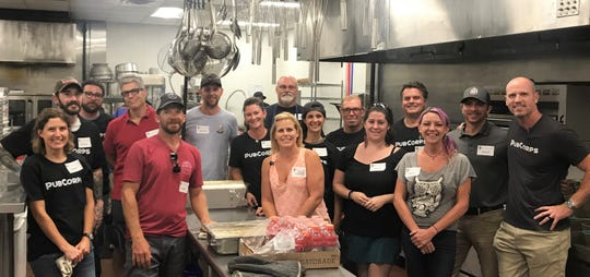 PubCorps volunteers serve meals at the Asheville Buncombe County Christian Ministry's Veterans Restoration Quarters.