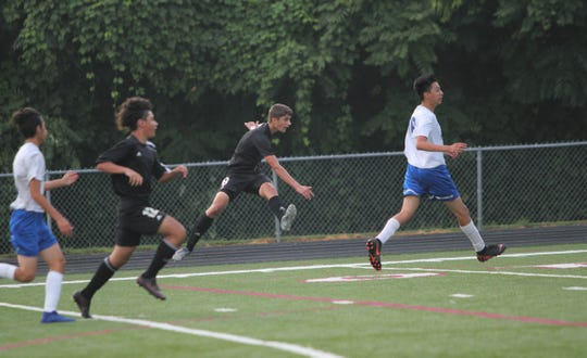 Jason Gun fires a shot at the goal during Owen's 3-0 win over McDowell on Aug. 21.