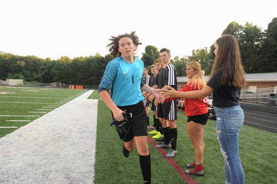 Owen goalkeeper Sean Henderson is introduced as the Warhorses take the field to face McDowell on Aug. 21.