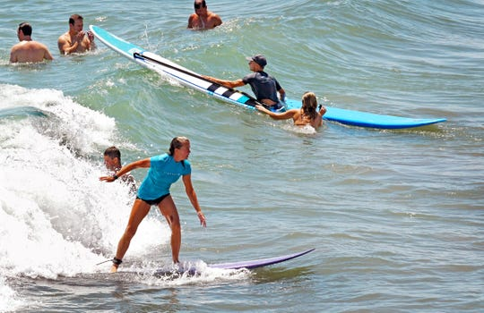 Scenes of surfers and beachgoers at the Westgate Resorts Cocoa Beach Pier in this August 2019 file photo.