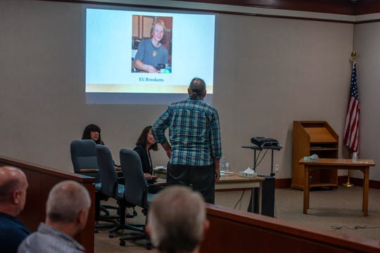 Eli Brookens' dad Bob Brookens pauses to gaze at a photograph of his son before speaking at a sentencing hearing for Steven Bourgoin in Vermont Superior Court in Burlington on Monday, August 26, 2019. Bourgoin was convicted in the deaths of five teenagers, including Eli Brookens, in a crash on I-89 in Williston in October 2016.