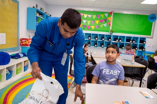 Srinivas Dittakavi, left, gets his son, Arjun Dittakavi, 6, settled in his first-grade class at Windsor Park Elementary School on Monday, August 26, 2019. It is one of three new schools in the Corpus Christi Independent School District this year.