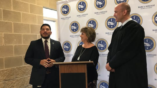 Nueces County District Attorney Mark Gonzalez, left, Rebecca Mohat, president of Nueces County Juvenile Justice Volunteers Inc., and County Judge Tim McCoy address media during a press conference at the Nueces County Juvenile Justice Center on Monday, Aug. 26, 2019.