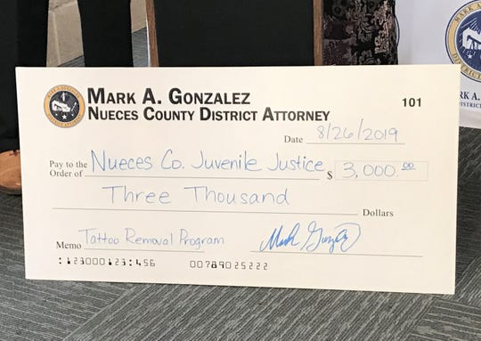The Nueces County District Attorney's Office presented Nueces County Juvenile Justice Volunteers Inc. with a $3,000 check for a tattoo removal program at the center on Monday, Aug. 26, 2019.