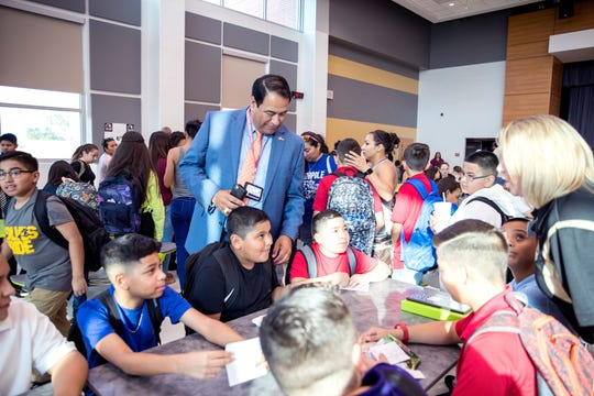 Corpus Christi Independent School District Superintendent Roland Hernandez talks with students on the first day of school at Cunningham Middle School at South Park on Monday, August 26, 2019. It is one of three new schools in the CCISD this year.