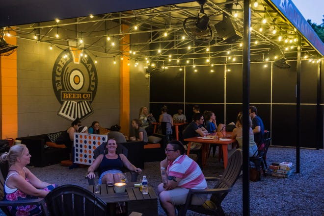 Eight & Sand opened its new outdoor space, The Caboose, earlier this summer. It is just one of the cool brewery spaces that allow you to take your sipping outside.