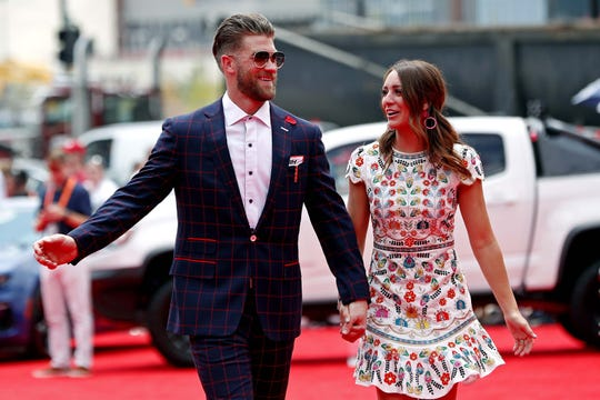 Bryce and Kayla Harper walk the red carpet on the red carpet before the 2018 MLB home run derby at Nationals Ballpark. The couple became first-time parents with the birth of Krew Aron Harper on Aug. 22.