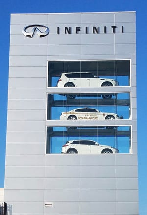 There is a FortWright police cruiser sitting inside the 55-foot Infiniti showcase tower overlooking 1-71/75 in Northern Kentucky.