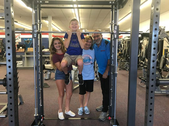 "For 30 years, the Kaplans ""pumped you up"" at Reps Fitness Supply on Route 22 in Somerville. But as of Sept. 15, Mitch and Karen Kaplan, here with grandchildren Chloe and Ryan Wardlow, are retiring and a new fitness enterprise will take over the store, continuing the Reps legacy."