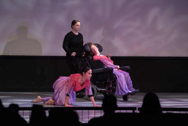 "Calry Finley with Marisa Joshi and Shannon Scully during her performance of ""Avril 14th,"" her original choreography."