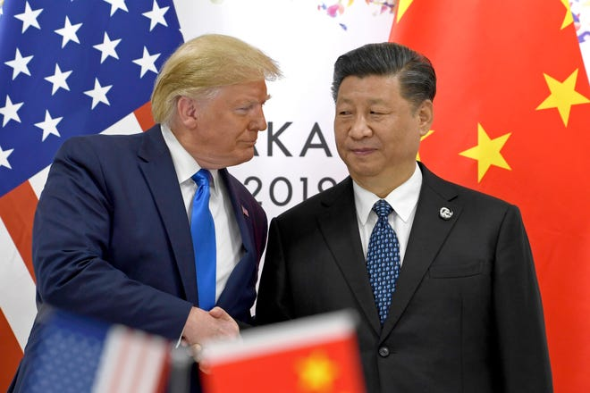 U.S. President Donald Trump shakes hands with Chinese President Xi Jinping during a meeting of the G-20 summit on June 29, 2019, in Osaka, western Japan. Businesses that have already lost revenue or profits to Trump's tariffs on imports from China and that country's retaliatory duties say they can't easily find alternatives in other countries.
