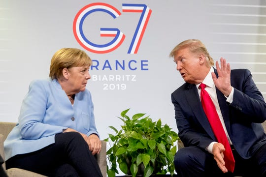 U.S. President Donald Trump and German Chancellor Angela Merkel participate in a bilateral meeting at the G-7 summit in Biarritz, France, Monday, Aug. 26, 2019.