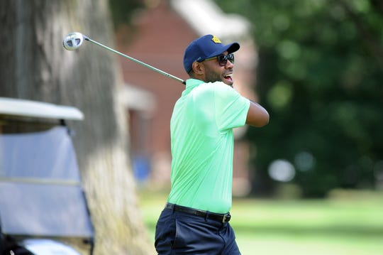 Jimmy King, a former Michigan Fab Five member, tees off during Monday's Jalen Rose Leadership Academy Celebrity Golf Classic at the Detroit Golf Club.