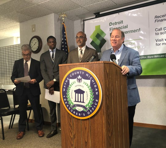 Detroit Mayor Mike Duggan speaks at a news conference about Financial Empowerment Centers opening in the city to offer low-income residents access to one-on-one financial counseling help.
