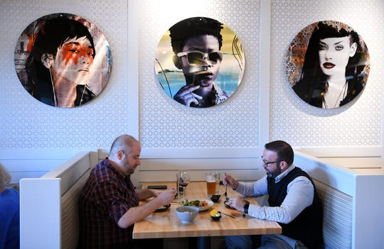 From left, Jared Rothberger of Bloomfield Hills and Daniel Mesa of West Bloomfield at Zao Jun, share a small plate at a new Pan-Asian restaurant in Bloomfield Township, Mich. on Aug. 22, 2019.