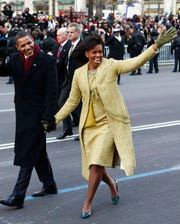 This Jan. 20, 2009 file photo shows President Barack Obama and first lady Michelle Obama, wearing Isabel Toledo as they walk the inaugural parade route in Washington. Toledo, the Cuban-American fashion designer has died. She was 59.