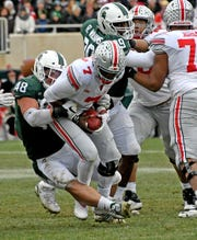 Kenny Willekes (48) and Raequan Williams (99) help lead a stout Michigan State defense.