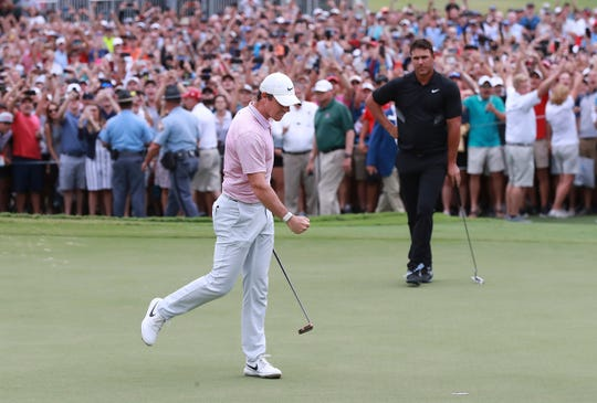 Rory McIlroy pumps his fist, patrons cheer, and Brooks Koepka looks on as McIlroy's birdie putt drops to win the Tour Championship on Sunday.