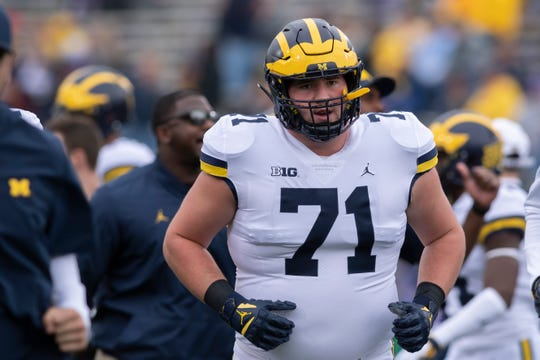 Michigan offensive lineman Andrew Stueber is out for the season with a knee injury, head coach Jim Harbaugh said.