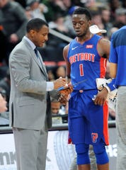 Reggie Jackson, right, averaged 15.4 points and 4.2 assists last season under first-year Pistons coach Dwane Casey.
