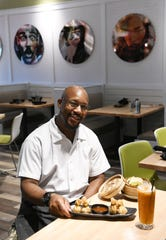 Chef de Cuisine Kwontrell Stowers with chicken money bags and bao buns at Zao Jun, a new Pan-Asian restaurant in Bloomfield Township, Mich. on Aug. 22, 2019.