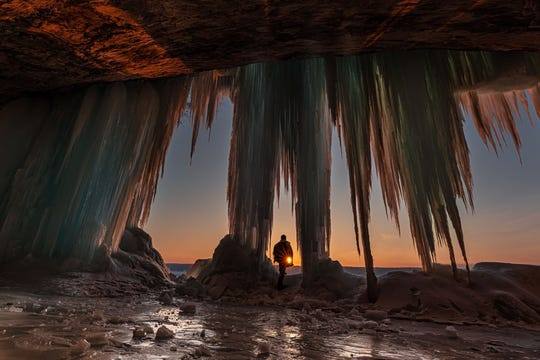 "Four-Season Fun People's Choice Award: ""Better Than Coffee,"" by Thomas Bos of White Lake, taken at sunrise at an ice cave at Grand Island National Recreation Area."
