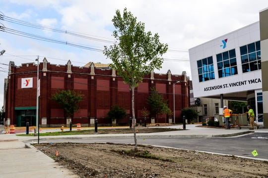 Construction crews are putting the finishing touches on the new Ascension St. Vincent YMCA building, located across the street from the old facility, in Downtown Evansville, Ind., Monday afternoon, Aug. 26, 2019. The new facility will open to the public on September 5 with a grand opening event scheduled from 4-6 p.m.