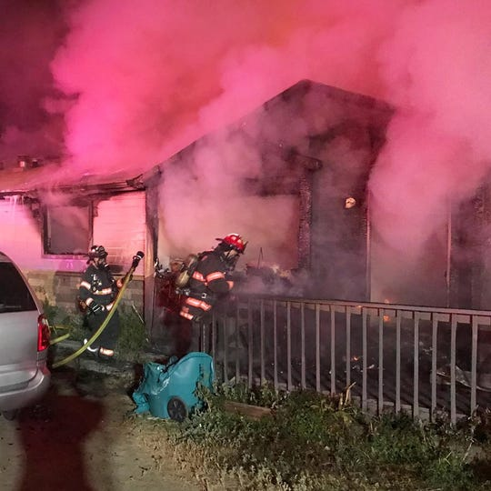 Firefighters battle an early Saturday morning blaze that claimed the lives of two people at 7800 Costigan Ave. in south Fort Collins.