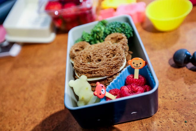 Broccoli rabe, two bear sandwiches, raspberries and an apple bear make up one of Jim Kroll's bento-box lunches. He's made more than 900 of these for his two elementary-school daughters.