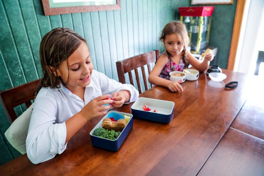 Chaya, 9, and her sister Heather, 6, have fun with lunch. Jim Kroll started making intricate, bento-box lunches for his daughters five years ago. Now, he can't stop. He's ordered dozens of tools to craft koala sandwiches, apple elephants and marshmallow cows. The lunches are part neurosis, part love for his girls. But they're adorably delicious.