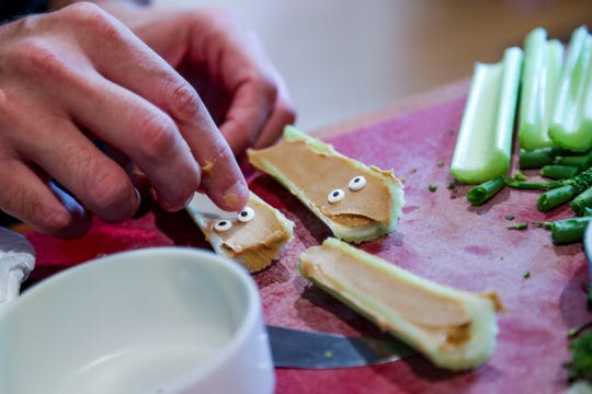 Candy eyes added to peanut butter filled celery sticks. Jim Kroll started making intricate, bento-box lunches for his daughters five years ago. Now, he can't stop. He's ordered dozens of tools to craft koala sandwiches, apple elephants and marshmallow cows. The lunches are part neurosis, part love for his girls. But they're adorably delicious.