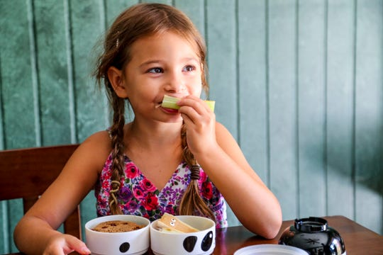 Heather ,6, enjoys her lunch. Jim Kroll started making intricate, bento-box lunches for his daughters five years ago. Now, he can't stop. He's ordered dozens of tools to craft koala sandwiches, apple elephants and marshmallow cows. The lunches are part neurosis, part love for his girls. But they're adorably delicious.