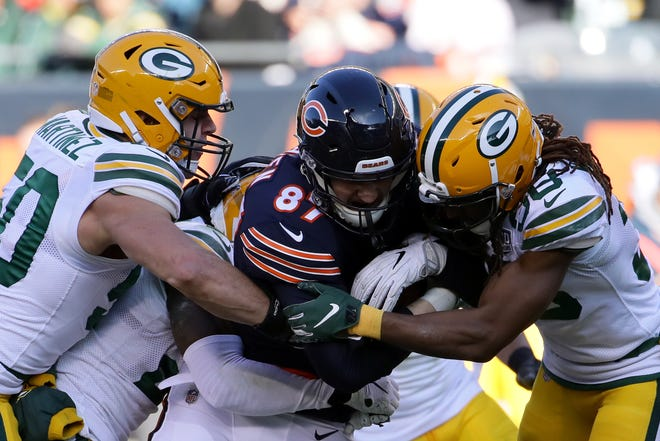 Blake Martinez of the Green Bay Packers grabs Adam Shaheen of the Chicago Bears at Soldier Field on Dec. 16, 2018.