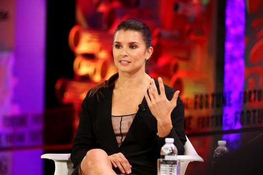 "Danica Patrick speaks onstage at the Fortune Most Powerful Women Summit 2018. She just launched her own ""Pretty Intense"" podcast."