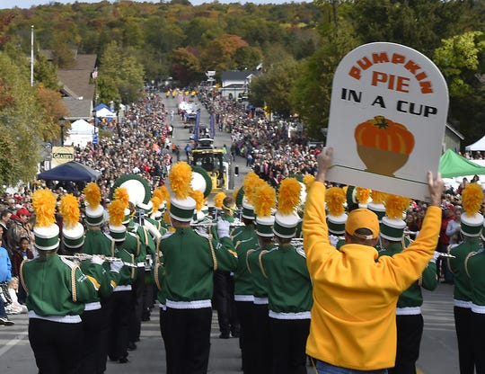 Thousands of people line State 42 in Sister Bay for its traditional Fall Fest parade, which organizers say is the largest parade in Door County.
