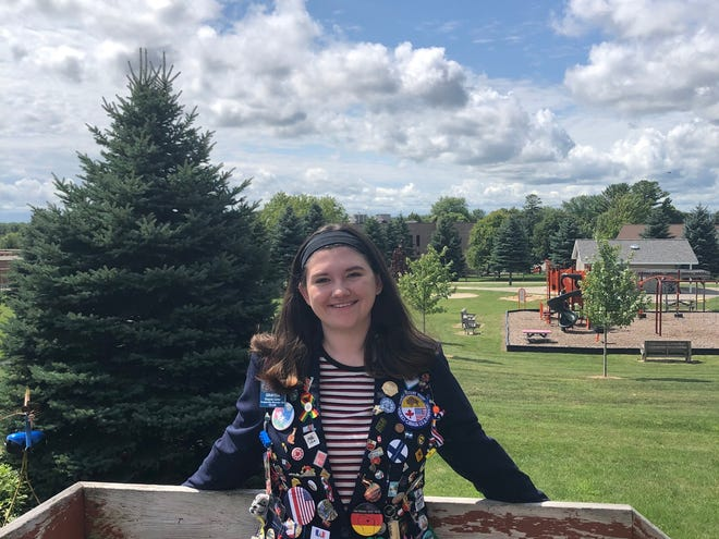 Graycia Carter wears her Rotary Youth Exchange jacket featuring souvenirs from her year in Finland. Local high school students interested in spending a year abroad as an exchange student are invited to an informational meeting Sept. 10 in Sturgeon Bay.