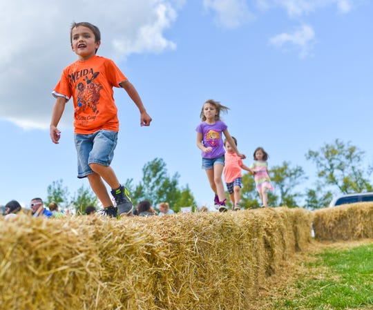 Mason Laster races down a row of hay bales at the Oneida Big Apple Fest in 2016.