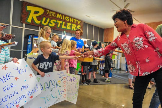 Students from various schools in the Great Falls Public Schools system greet faculty and staff with thank you signs and snacks at the conclusion of the convocation kicking off the 2019-2020 school year, Monday morning in the CMR Fieldhouse.
