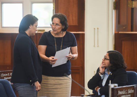 Vice Speaker Telena Nelson, left, Sen. Telo Taitague, center, and Sen. Sabina Perez confer during a session recess at the Guam Congress Building in Hagåtña, Aug. 26, 2019.
