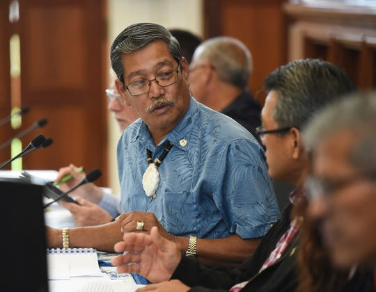Sen. Joe S. San Agustin, left, and Office of Finance and Budget Director Stephen Guerrero converse during a session recess at the Guam Congress Building in Hagåtña, Aug. 26, 2019.