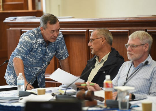 Sen. James C. Moylan, left, speaks with Bureau of Budget and Management Research Director Lester Carlton during a session recess at the Guam Congress Building in Hagåtña, Aug. 26, 2019.