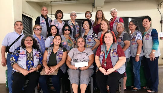 The Guam Sunshine Lions Club made a monetary donation to Joleen Cepeda Villamor, 42, of Dededo,  to assist with medical treatment expenses  on Aug. 17. Seated with members is Josephine Mae Cepeda, on behalf of her daughter Joleen.