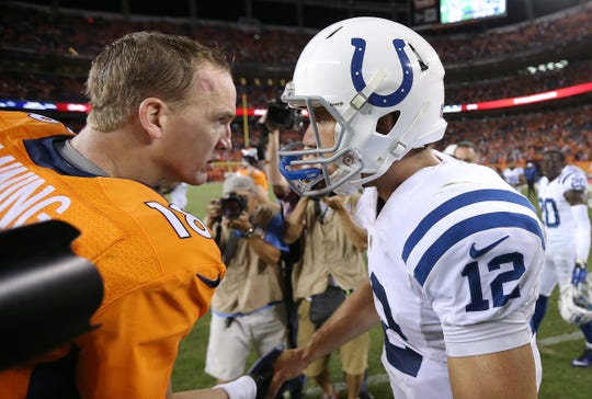 Denver Broncos Peyton Manning shakes hands with Indianapolis Colts Andrew Luck after the game.  The Indianapolis Colts play the Denver Broncos Sunday, September 7, 2014, evening at Sports Authority Field at Mile High in Denver CO.