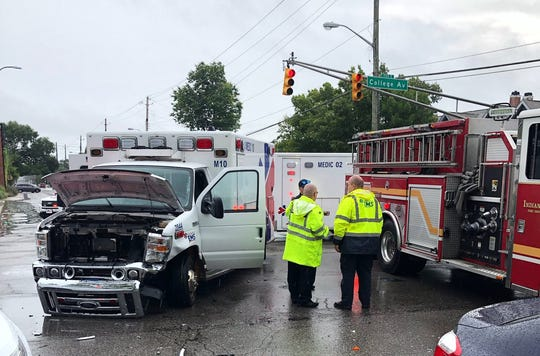 Two people suffered slight injuries after a driver passed an IndyGo bus and crashed into an ambulance just north of Downtown Monday morning, IFD said.