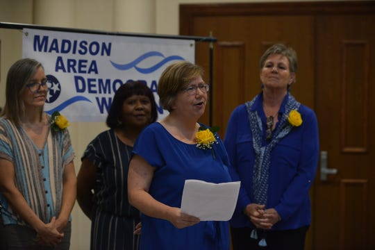 Jennifer Trently, a Madison Area Democratic Women scholarship committee member, speaks about suffragist Sue Shelton White's role in securing women's right to vote at Jackson City Hall on Aug. 26, 2019.