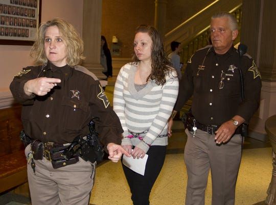 Carolann Clear is led to Tippecanoe Superior Court 1 to be sentenced in the death of her boyfriend, Jeremy Gibson Friday, January 18, 2013, at the Tippecanoe County Courthouse in Lafayette.