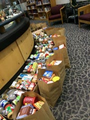 Food donations for 150 Christmas baskets were collected at the New Albany High School Library in December, including Christmas meals complete with either a ham or turkey and enough food to get each family through their extended holiday breaks.